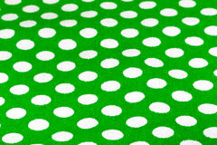 Green cloth with white polka dots. Background. Toned Royalty Free Stock Image