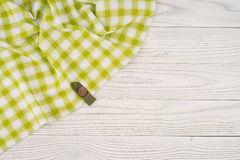 The green cloth on a white wooden table. Top view Royalty Free Stock Photos