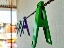 Green clothes clip on a rope royalty free stock images