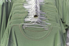 Green clothes on hangers. In daylight Royalty Free Stock Image