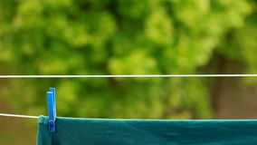 Green clothes hanging to dry on laundry line Royalty Free Stock Photography