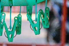 Green clothes peg. Closeup of circle green clothes peg in the house , concept zoom image, blur background Stock Photo