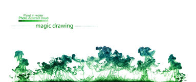 Green clouds of paint in water. Abstract figure Stock Images