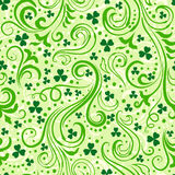 Green clover backgrounds. Seamless light green St. Patrick's day background with floral swirls and clover leaves stock illustration