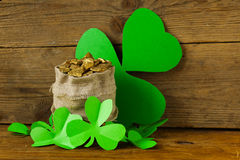 Green clover leaves and a bag of gold Stock Photography
