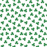 Green clover leaves. Cute funny seamless background pattern with stylized green clover leaves isolated on the white fond. Vector illustration eps 10 royalty free illustration