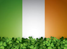 Green clover leaves and Irish flag Royalty Free Stock Images