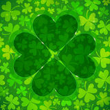 Green clover shape on light clovers background Royalty Free Stock Photography