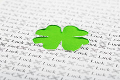 Green clover shape and paper background Stock Image