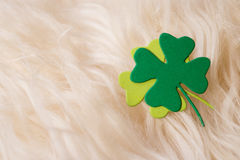 Green clover symbol on sheep's clothing Royalty Free Stock Images