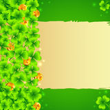 Green clovers background with golden coins Royalty Free Stock Photo