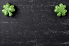 Green Clovers on Chalkboard Background Stock Photo