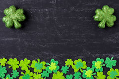 Green Clovers on Chalkboard Background Stock Photos
