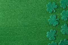 Green Clovers or Shamrocks  on Green Background Background Royalty Free Stock Photography