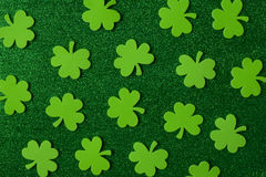 Green Clovers or Shamrocks  on Green Background Stock Photography