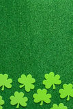 Green Clovers or Shamrocks  on Green Background Royalty Free Stock Photos