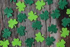 Green Clovers or Shamrocks  on Rustic Wood Royalty Free Stock Image