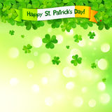 Green clovers on shining bokeh effect background Royalty Free Stock Images
