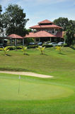 Green And Clubhouse. A golf green near the clubhouse Stock Image