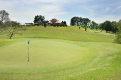 Green And Clubhouse. A golf green near the clubhouse Stock Photography