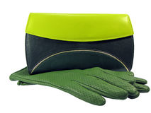 Green clutch and leather gloves Stock Photo
