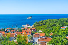 The green coast. The aerial view on the small Adriatic resort of Petrovac with its tiny rocky islets, Montenegro Stock Images