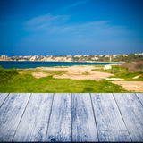 Green coastline and blue water of the Mediterranean Sea over old Stock Photography