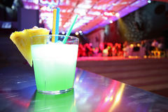 Green cocktail. In dance club royalty free stock images