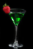 Green cocktail absinth decorated with red strawberry in martini Stock Photography
