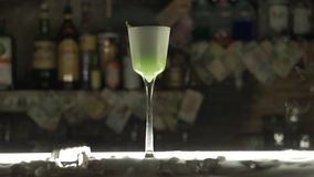 Green cocktail at the bar.  stock video