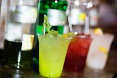 Green cocktail on a bar Stock Photos
