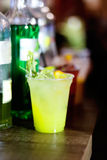 Green cocktail on a bar Stock Image