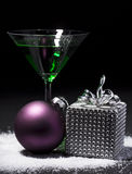 Green cocktail with christmas gift package and christmas ball Royalty Free Stock Image