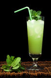 Green cocktail with cubes ice Royalty Free Stock Images