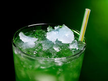 Green cocktail  on dark background Royalty Free Stock Photos