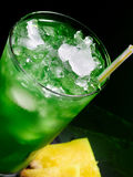 Green cocktail  on dark background Royalty Free Stock Photography