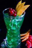 Mint green juice with raspberries and currants stock photo