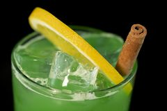 Green Cocktail with green juices, alcohol and lime wedge stock photography