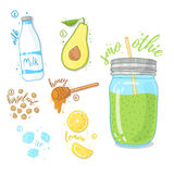 Green cocktail for healthy life. Smoothies with avocado, cow milk, honey and hazelnut. Recipe fruit smoothie in a glass Stock Images