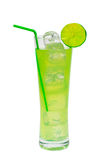 Green cocktail with lime. Green cocktail with slice of lime isolated on a white background royalty free stock images