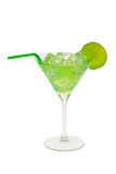 Green cocktail with lime. Green cocktail with slice of lime isolated on a white background stock image