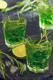 Green cocktail with lime, soda, crushed ice and tarragon leaves. Royalty Free Stock Image