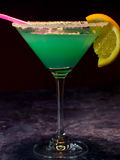 Green cocktail with orange Royalty Free Stock Images