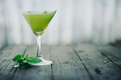 Green cocktail. Selective focus. Blurred foreground and background Stock Image
