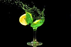 Green cocktail splash Royalty Free Stock Images