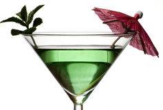 Green cocktail with umbrella Royalty Free Stock Photo