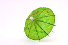 Green cocktail umbrella, top view Stock Photography