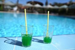 Green cocktails on the background of the pool stock photo