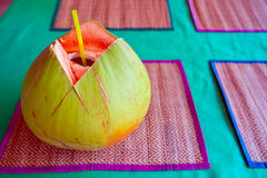 Green coconut with drinking straw Stock Photo