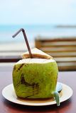 Green coconuts. With drinking straw stock photo
